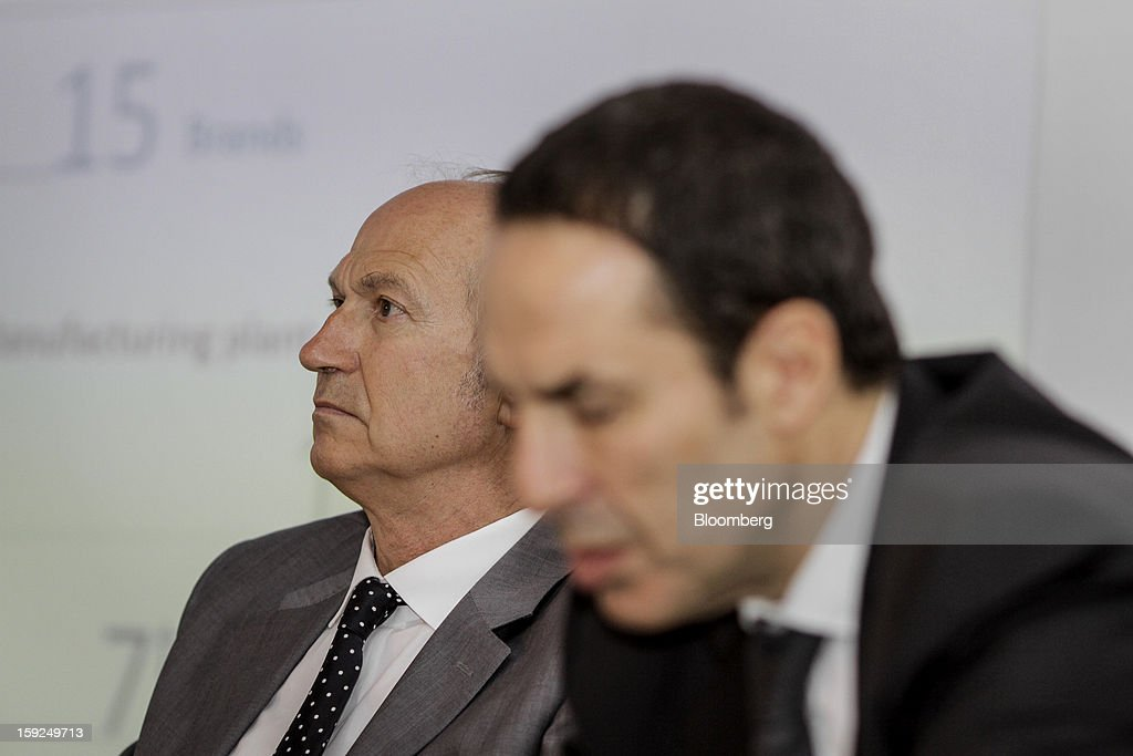 Jean-Paul Agon, chief executive officer of L'Oreal SA, left, and Laurent Attal, executive vice president of research and innovation for L'Oreal SA, listen during a news conference for the opening of the company's first research and innovation center in Mumbai, India, on Thursday, Jan. 10, 2013. L'Oreal SA, the world's largest cosmetics maker, today inaugurated its new Indian R&I center. Photographer: Dhiraj Singh/Bloomberg via Getty Images