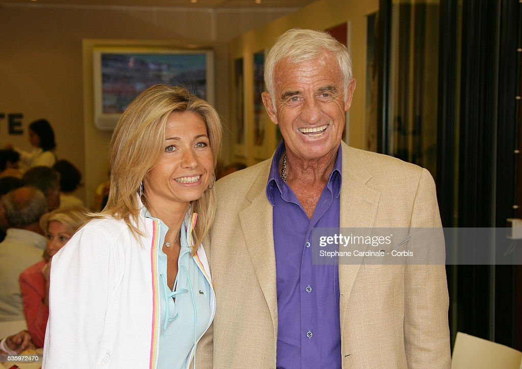 Jean-Paul Belmondo and his wife, Natty visit the Roland Garros village during the 2005 French Open Tennis.