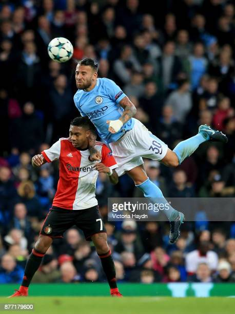 JeanPaul Boetius of Feyenoord and Nicolas Otamendi of Manchester City battle for possession in the air during the UEFA Champions League group F match...