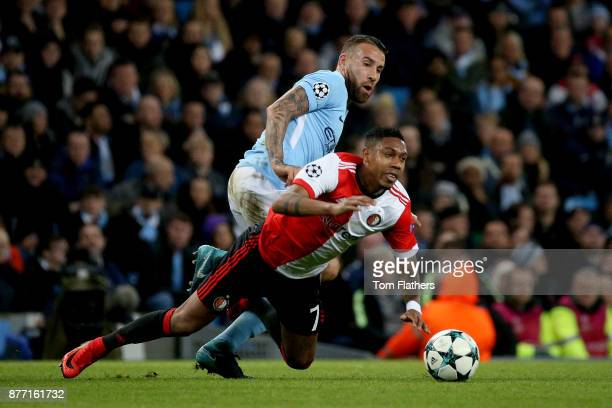 JeanPaul Boetius of Feyenoord is challenged by Nicolas Otamendi of Manchester City during the UEFA Champions League group F match between Manchester...