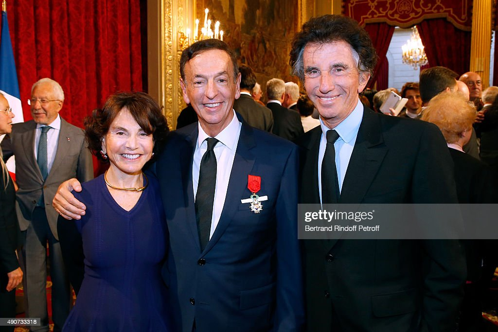 Jean-Paul Claverie standing between Jack Lang and his wife Monique Lang attend Director of sponsorship LVMH Jean-Paul Claverie receives Insignia of Officer of the Legion of Honor at Elysee Palace on September 30, 2015 in Paris, France.