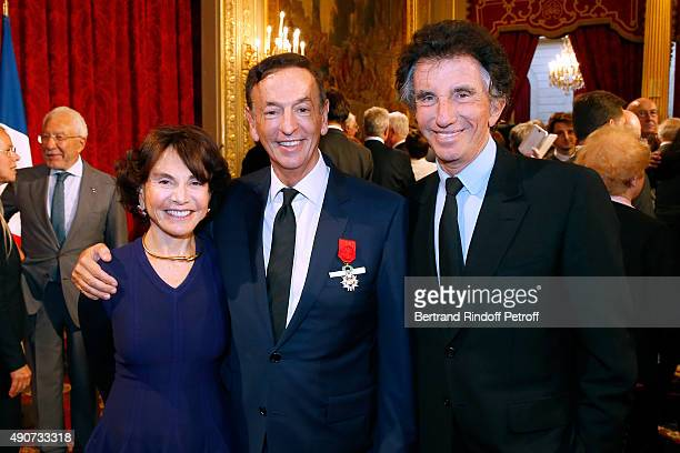 JeanPaul Claverie standing between Jack Lang and his wife Monique Lang attend Director of sponsorship LVMH JeanPaul Claverie receives Insignia of...