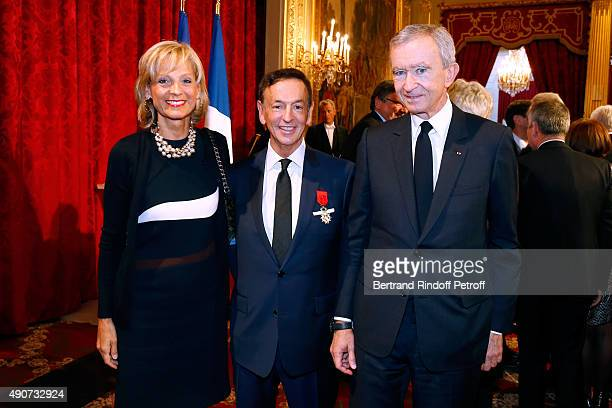 JeanPaul Claverie standing between Owner of LVMH Luxury Group Bernard Arnault and his wife Helene Arnault attend Director of sponsorship LVMH...