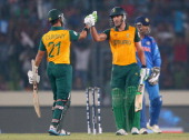 JeanPaul Duminy congratulates Faf du Plessis of South Africa hits he hit a six as MS Dhoni of India looks on during the ICC World Twenty20 Bangladesh...