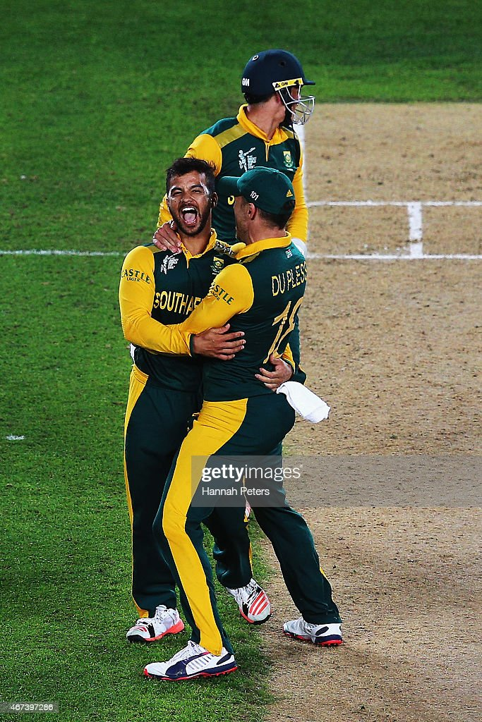 Jean-Paul Duminy of South Africa celebrates the wicket of Ross Taylor of New Zealand with <a gi-track='captionPersonalityLinkClicked' href=/galleries/search?phrase=Francois+du+Plessis&family=editorial&specificpeople=5411977 ng-click='$event.stopPropagation()'>Francois du Plessis</a> of South Africa during the 2015 Cricket World Cup Semi Final match between New Zealand and South Africa at Eden Park on March 24, 2015 in Auckland, New Zealand.