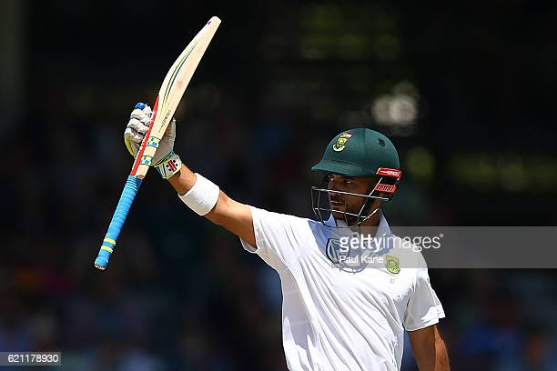 JeanPaul Duminy of South Africa raises his bat to the players rooms after reaching his half century during day three of the First Test match between...