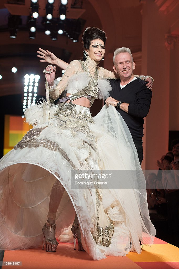 Jean-Paul Gaultier and a model walk the runway during the Jean Paul Gaultier Spring/Summer 2013 Haute-Couture show as part of Paris Fashion Week at on January 23, 2013 in Paris, France.