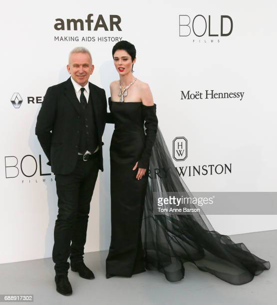 JeanPaul Gaultier and Coco Rocha arrive at the amfAR Gala Cannes 2017 at Hotel du CapEdenRoc on May 25 2017 in Cap d'Antibes France