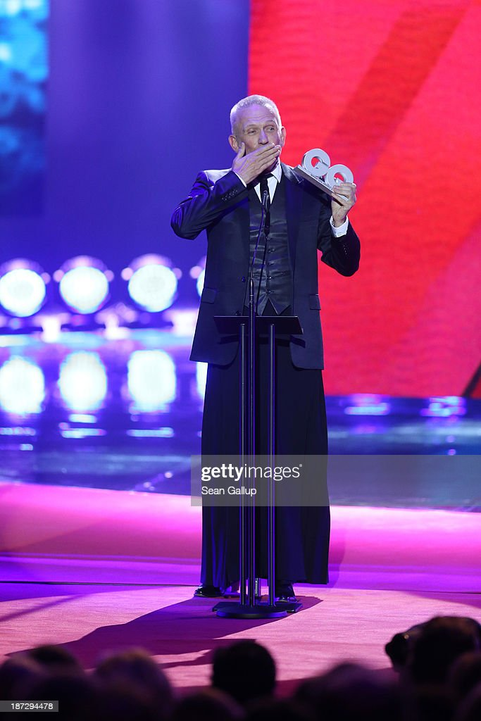 (TO BE USED EXCLUSIVELY FOR POST-EVENT REPORTING TO GQ MEN OF THE YEAR 2013) Jean-Paul Gaultier receives an award on stage at the GQ Men Of The Year Award at Komische Oper on November 7, 2013 in Berlin, Germany.