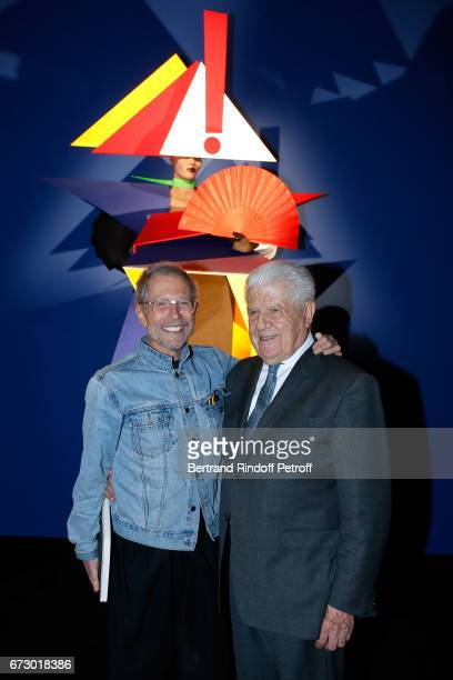 Jeanpaul Goude and CEO of Cacharel Jean Bousquet pose in front the works of JeanPaul Goude during the 'Societe des Amis du Musee d'Art Moderne du...