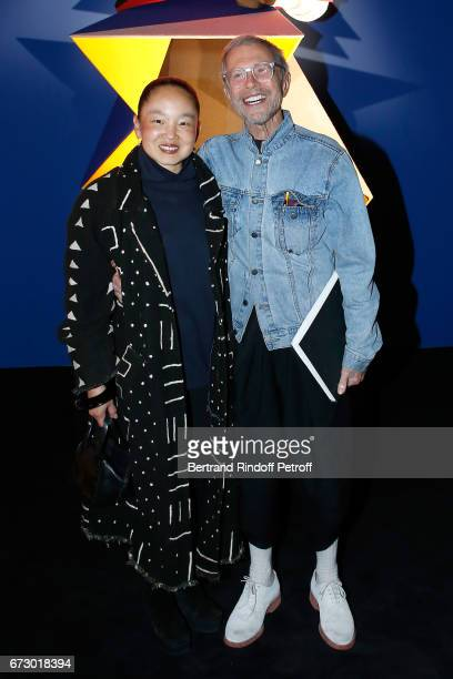 JeanPaul Goude and his wife Karen pose in front the works of JeanPaul Goude during the 'Societe des Amis du Musee d'Art Moderne du Centre Pompidou'...