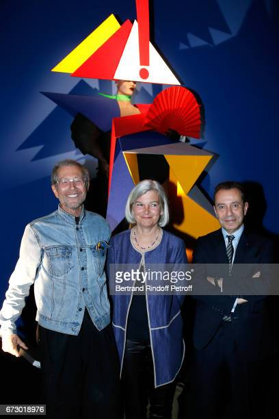 Jeanpaul Goude Bruno Racine and his wife pose in front the works of JeanPaul Goude during the 'Societe des Amis du Musee d'Art Moderne du Centre...