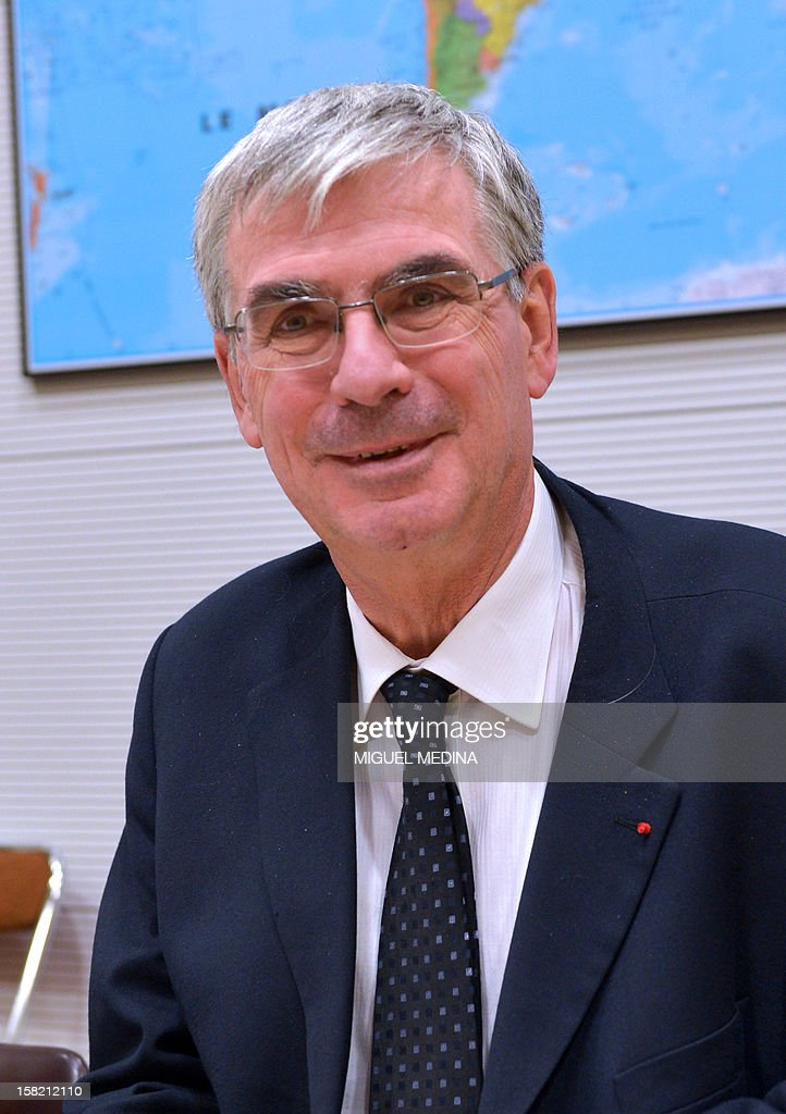 Jean-Paul Herteman, CEO of Safran sits at the French national assembly on December 11, 2012 in Paris. Maker of infrared detectors Sofradir, a co-owned company by Thales and Safran, announced today that it had won it's first tender agreement to equip satelites of the Indian Space Agency. AFP PHOTO / MIGUEL MEDINA