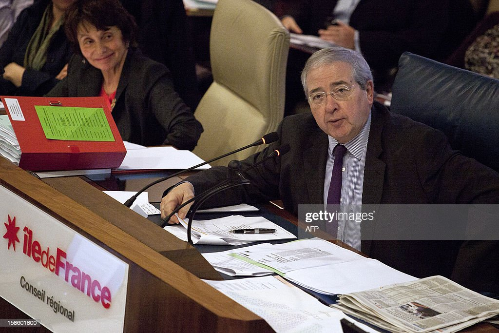 Jean-Paul Huchon, president of the Ile-de-France region and Henriette Zoughebi, 11th vice-président in charge of high schools attend a plenary session of the Regional Council on December 20, 2012 at in Paris. AFP PHOTO EDOUARD DE MARESCHAL