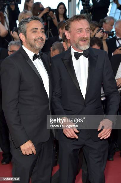 JeanPaul Rouve and a guest attend the 'Okja' screening during the 70th annual Cannes Film Festival at Palais des Festivals on May 19 2017 in Cannes...