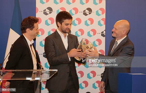 JeanPaul Salome president of UniFrance organisation in charge of promoting the French cinema abroad gives an award to Dimitri Rassam producer with...