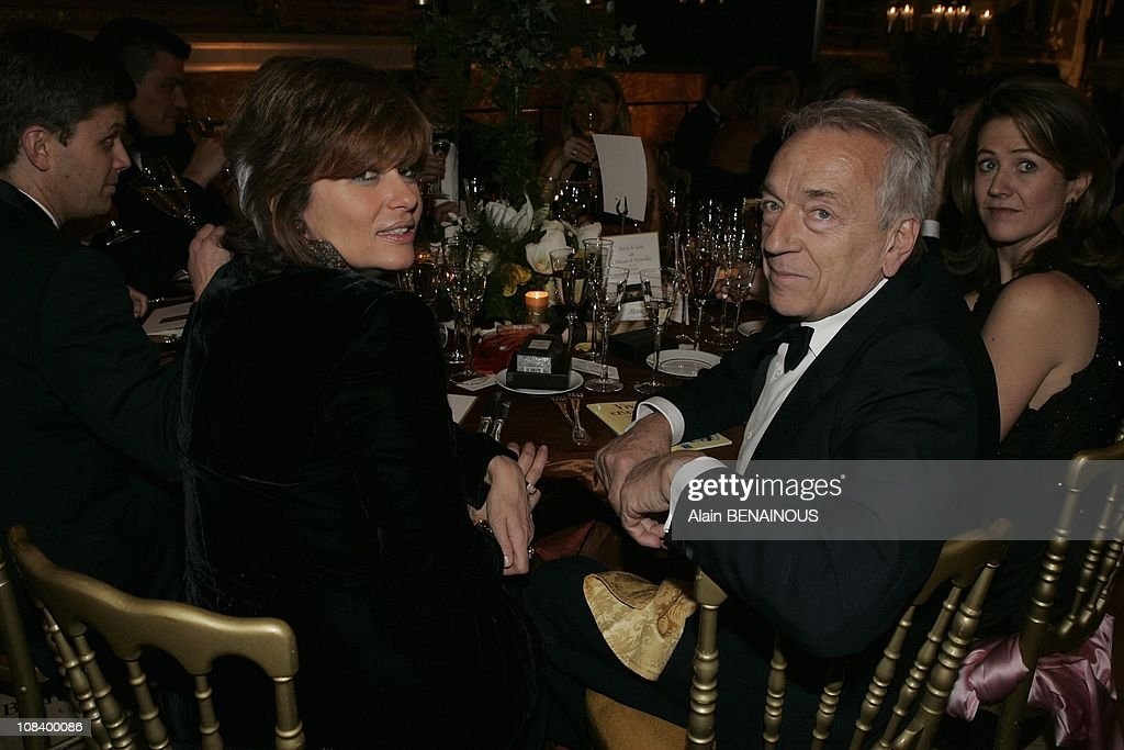 JeanPierre Cassel and his wife in Versailles France on January 31 2005