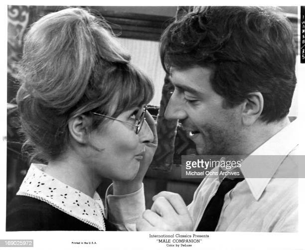 JeanPierre Cassel touching Catherine Deneuve face in a scene from the film 'Male Companion' 1964