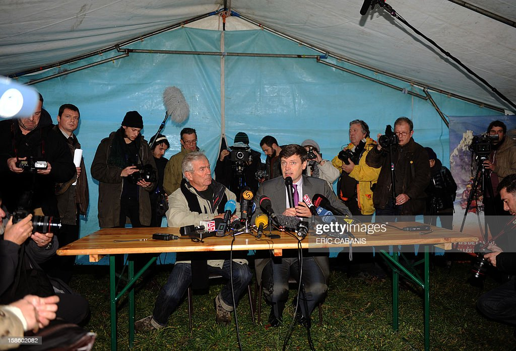 Jean-Pierre Delord (L), the mayor of Bugarach, and Eric Freysselinard, the prefect of the Aude department of France, give a press conference on December 20, 2012 in Bugarach. French authorities have pleaded with New Age fanatics, sightseers and media crews not to converge on the tiny village some believe will be one of the few places spared when the world supposedly ends on December 21, 2012. 'I am making an appeal to the world -- do not come to Bugarach,' said mayor Jean-Pierre Delord two days ago, echoing calls from regional officials who noted that police will from Wednesday block access to the southwestern village of 200 residents. AFP PHOTO / ERIC CABANIS