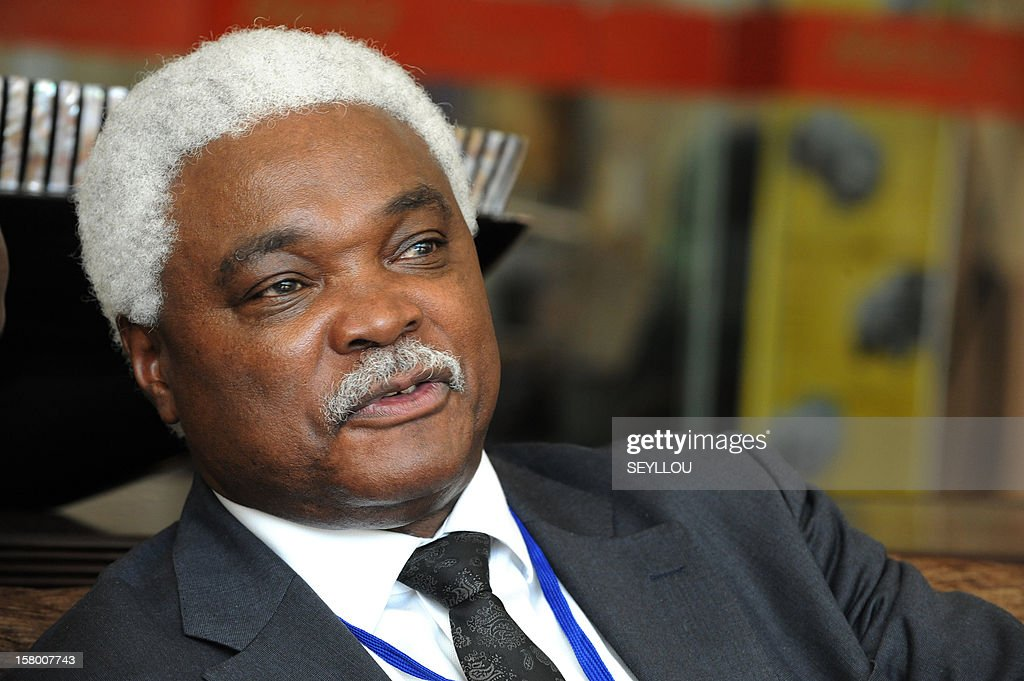 Jean-Pierre Elong Mbassi, secretary-general of the ''Local United African Cities and Governments'' (CGLUA) speaks during an interview as local representatives gathered during the sixth edition of Africities, on December 8, 2012 in Dakar. Local authorities called for a dialogue with Islamist armed groups in Northern Mali to avoid ''casualties'', according to the organizers of the event. AFP PHOTO/SEYLLOU