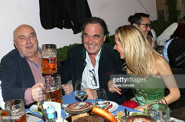 JeanPierre Goddet director Oliver Stone and his nice Caroline Goddet during the Oktoberfest at Kaeferschaenke at Theresienwiese on September 20 2016...