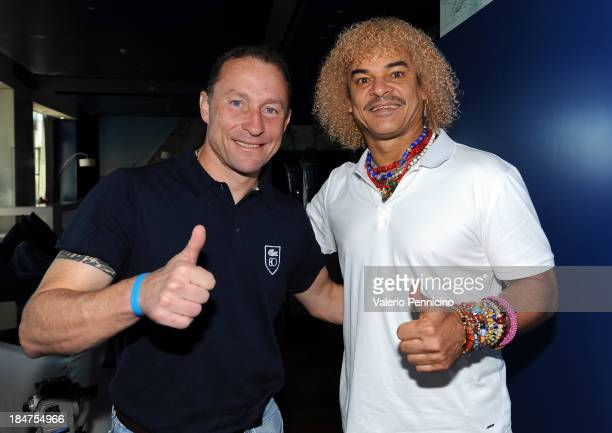 JeanPierre Papin and Carlos Valderrama pose for photographers ahead of their visit to the Champions Promenade at Grimaldi Forum on October 16 2013 in...