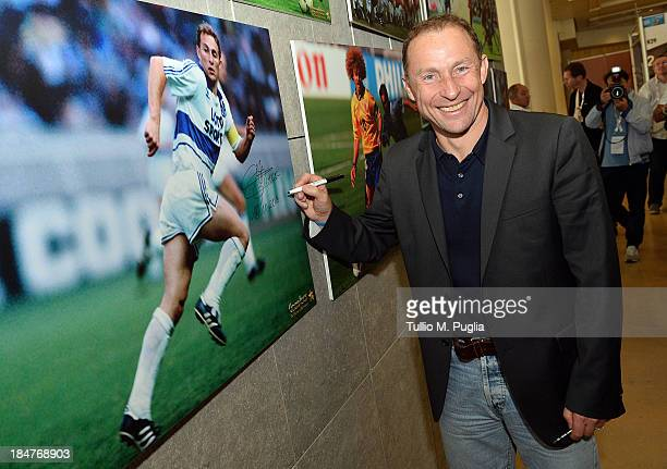 JeanPierre Papin signs a picture prior to the Golden Foot Award press conference at Grimaldi Forum on October 16 2013 in Monaco Monaco