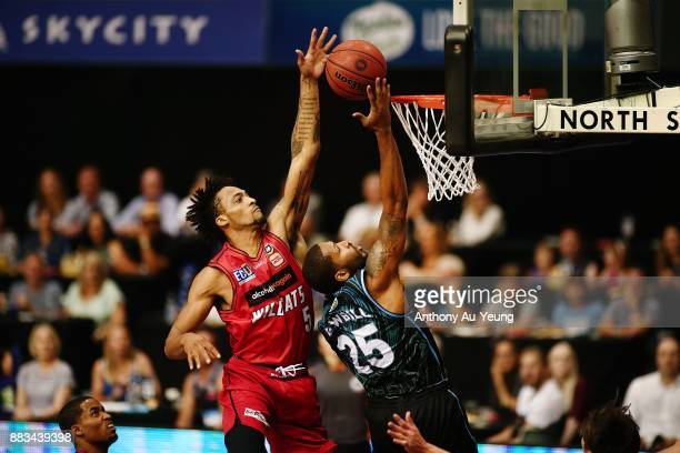 JeanPierre Tokoto of the Wildcats blocks the shot from Devonte DJ Newbill of the Breakers during the round eight NBL match between the New Zealand...