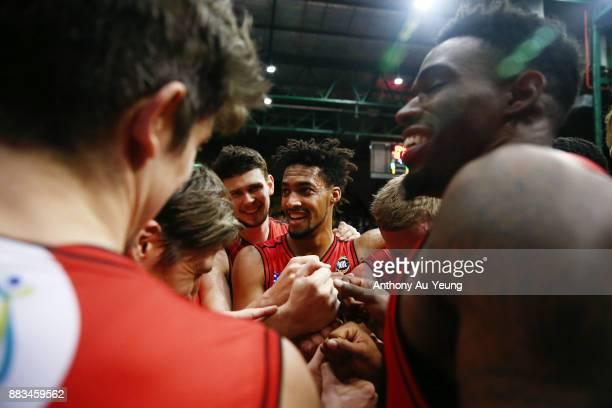 JeanPierre Tokoto of the Wildcats celebrates with the team after winning the round eight NBL match between the New Zealand Breakers and the Perth...