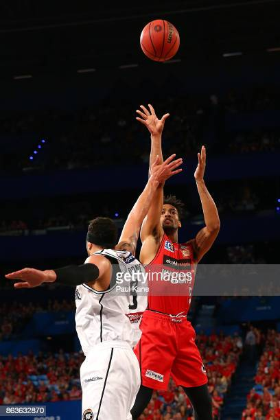 JeanPierre Tokoto of the Wildcats puts a shot up against Josh Boone of United during the round three NBL match between the Perth Wildcats and...
