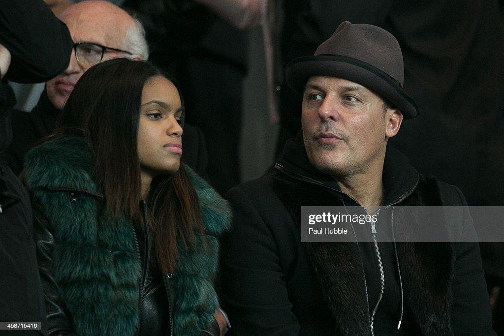 Jean-Roch Pedri (R) attends the Paris Saint Germain vs Olympique de Marseille football match at Parc des Princes on November 9, 2014 in Paris, France.