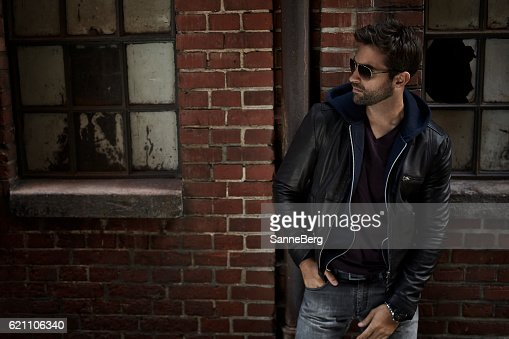 Jeans And Jacket Guy On Street At Night Stock Photo Thinkstock