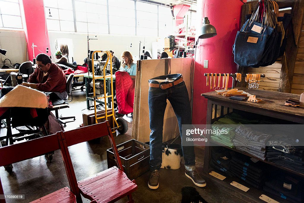 Jeans and other denim items sit on display in the work area at Detroit Denim in Detroit, Michigan, U.S., on Wednesday, June 12, 2013. The Commerce Department is scheduled to release monthly business inventories data on June 13. Photographer: Ty Wright/Bloomberg via Getty Images
