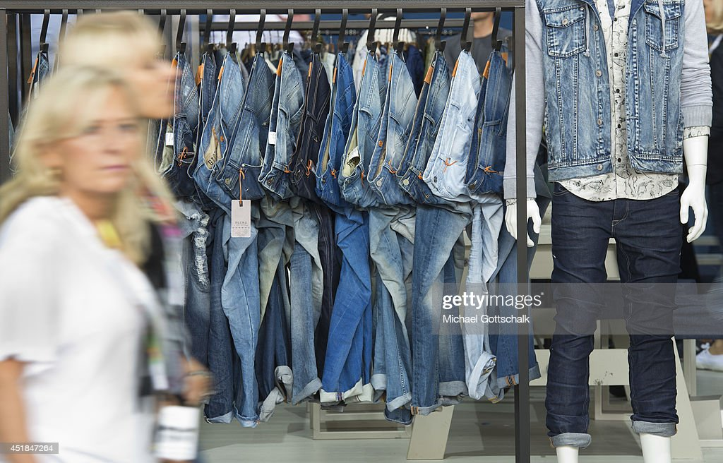 Jeans are presented in the booth of an exhibitor at the Bread and Butter trade show at the former Tempelhof airport on July 08, 2014 in Berlin, Germany.