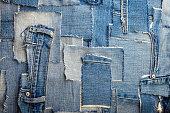 background made of old jeans rags close up