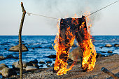 Pants burning on a rope on a seashore