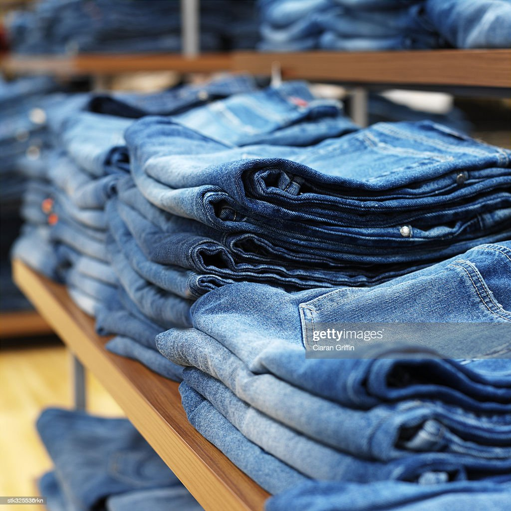 jeans on shelves in a clothing store : Stock Photo