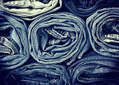stack of jeans in vintage style