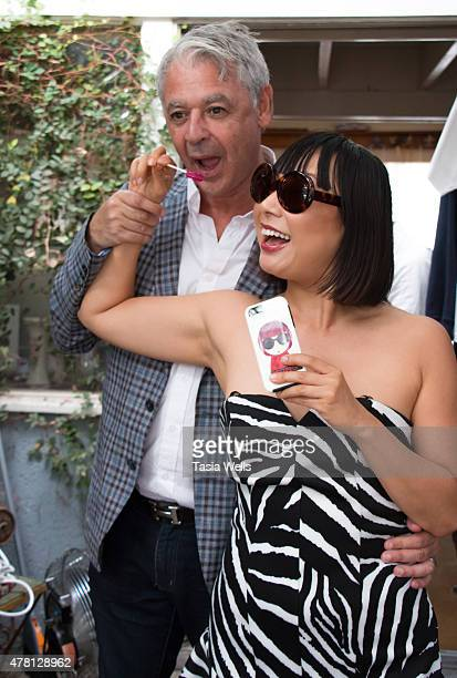 Jeanscom President Victor Dahan and MEGUMIO Founder Megumi Hosogai in MEGUMIO Sunglasses enjoying Zollipops at The SAP The Starving Artists Project...