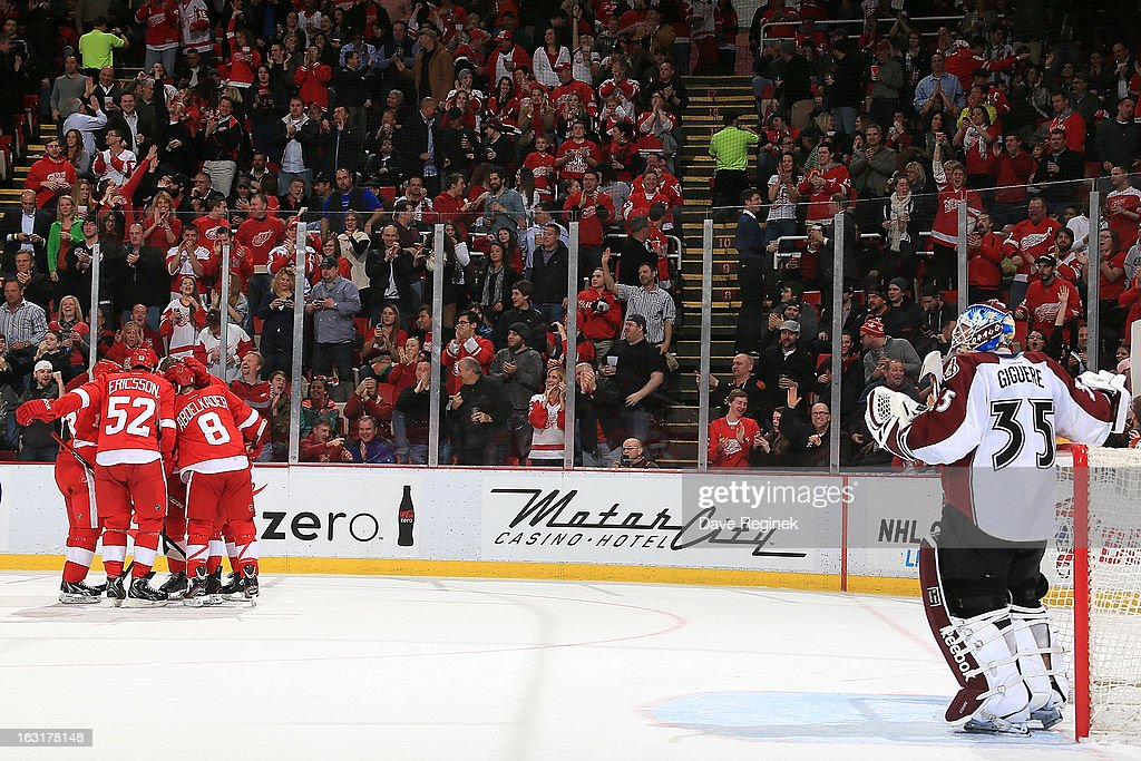 Jean-Sebastien Giguere #35 of the Colorado Avalanche looks on as Jonathan Ericsson #52, Justin Abdelkader #8, Pavel Datsyuk #13 & Daniel Cleary #11 of the Detroit Red Wings celebrate with teamate Niklas Kronwall #55 after scoring a goal during a NHL game at Joe Louis Arena on March 5, 2013 in Detroit, Michigan.
