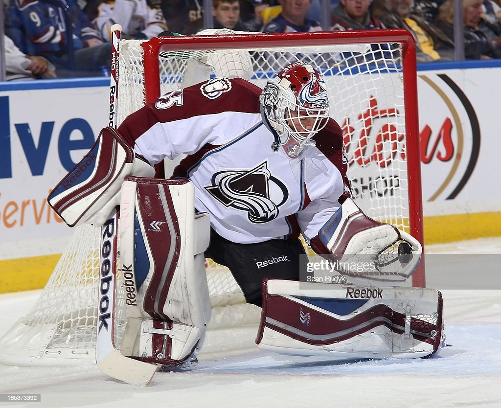 Jean-Sebastien Giguere #35 of the Colorado Avalanche makes a second-period glove save against the Buffalo Sabres on October 19, 2013 at the First Niagara Center in Buffalo, New York.
