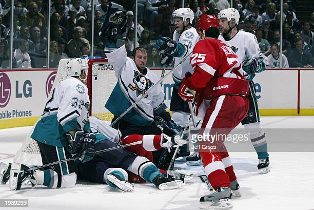 JeanSebastien Giguere of the Mighty Ducks of Anaheim shows the puck after making a save against the Detroit Red Wings during round one of the 2003...
