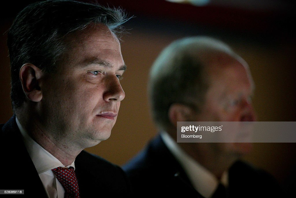Jean-Sebastien Jacques, incoming chief executive officer of Rio Tinto Group, left, and Chris Lynch, chief financial officer, listen during the company's annual general meeting in Brisbane, Australia, on Thursday, May 5, 2016. Rio Tinto Group, the second-largest mining company, reaffirmed its goal to raise annual iron ore output in Australia to 360 million metric tons amid forecast growth demand in Asia. Photographer: Patrick Hamilton/Bloomberg via Getty Images