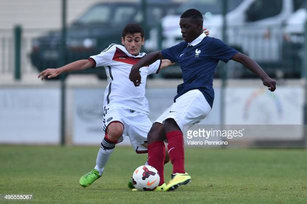 JeanVictor Makengo of France is challenged by Sahin Kosecik of Germany during the International Friendly match between U16 France and U16 Germany at...