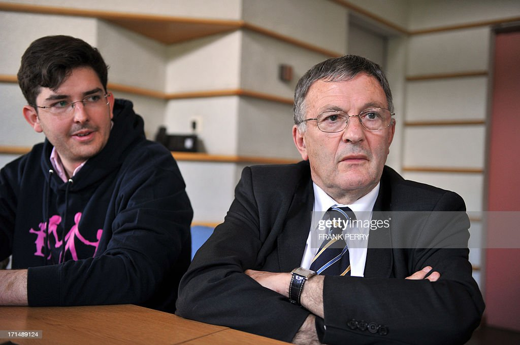 Jean-Yves Clouet (R), Mayor of Mesanger, western France, gives a press conference beside anti-gay marriage movement ''La Manif Pour Tous'' (demonstration for all) member, Alberic Dumont (L), at Mesanger town hall on June 25, 2015. Opposed to marrying same-sex couples at his town Hall, mayor Clouet received support from the anti-gay marriage movement ''La Manif Pour Tous''. Clouet declared to French newspaper Le Figaro on June 19 that he refused to marry gay couples at his town hall, but will abide by the law because of legal sanctions, he declared on June 21 to local Christian radio station Fidelite.