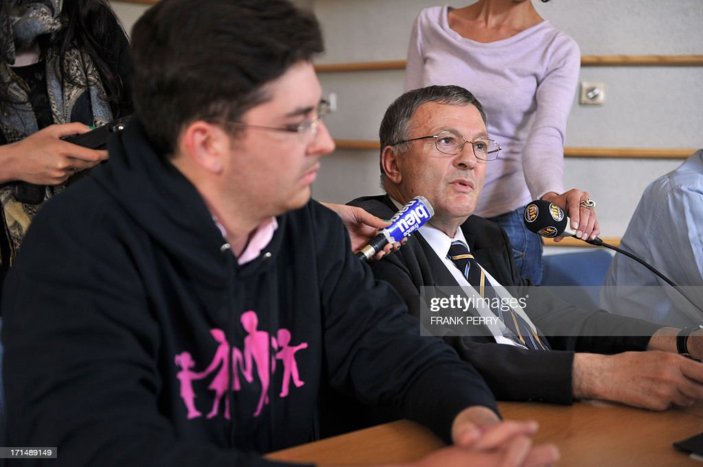 Jean-Yves Clouet (C), Mayor of Mesanger, western France, gives a press conference beside anti-gay marriage movement ''La Manif Pour Tous'' (demonstration for all) member, Alberic Dumont (L), at Mesanger town hall on June 25, 2015. Opposed to marrying same-sex couples at his town Hall, mayor Clouet received support from the anti-gay marriage movement ''La Manif Pour Tous''. Clouet declared to French newspaper Le Figaro on June 19 that he refused to marry gay couples at his town hall, but will abide by the law because of legal sanctions, he declared on June 21 to local Christian radio station Fidelite.