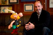 JeanYves Ferri who is to take over the script writing of the successful comic strip Asterix poses next to a figurine of the famous character on...