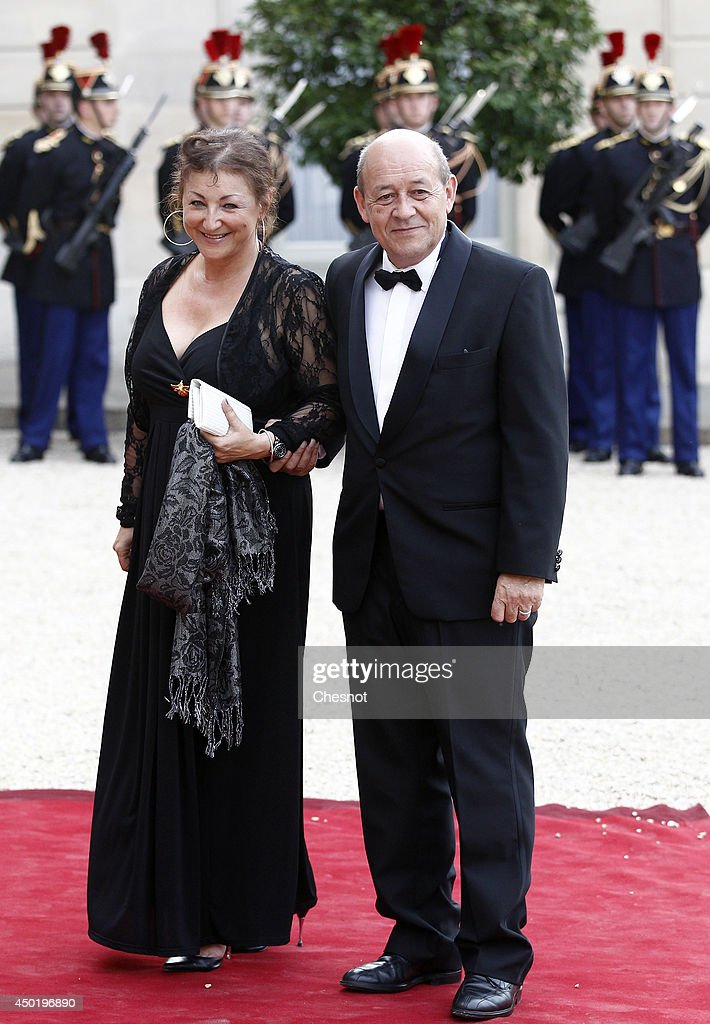 <a gi-track='captionPersonalityLinkClicked' href=/galleries/search?phrase=Jean-Yves+Le+Drian&family=editorial&specificpeople=2122785 ng-click='$event.stopPropagation()'>Jean-Yves Le Drian</a> (R) and his arrive at the Elysee Palace for a State dinner in honor of Queen Elizabeth II, hosted by French President Francois Hollande as part of a three days State visit of Queen Elizabeth II after the 70th Anniversary Of The D-Day on June 6, 2014 in Paris, France.