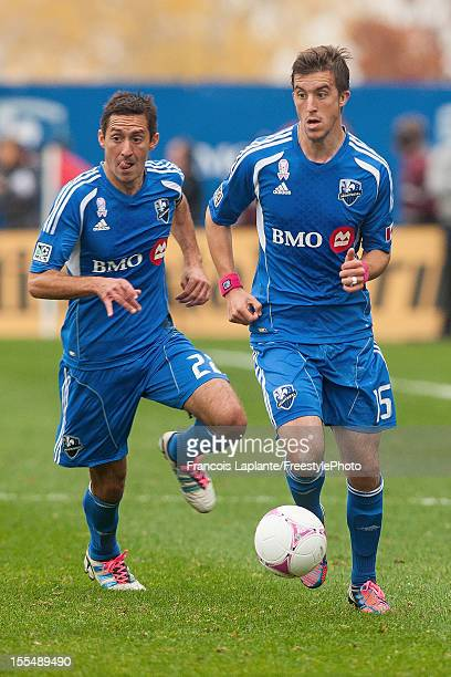 Jeb Brovsky and Davy Arnaud of the Montreal Impact run with the ball during the MLS match against the New England Revolution at Saputo Stadium on...
