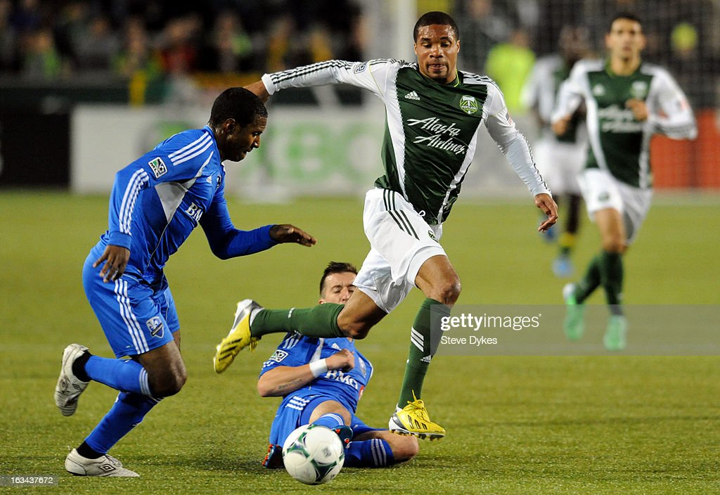 Jeb Brovsky #5 of Montreal Impact slides in to tip the ball away from Ryan Johnson #9 of Portland Timbers as Patrice Bernier #8 of Montreal Impact comes in to steal it during the second half of the game at Jeld-Wen Field on March 09, 2013 in Portland, Oregon. Montreal won the game 2-1.